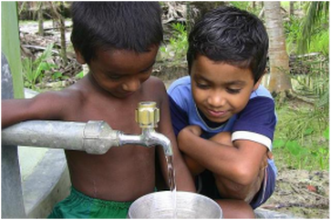 Photograph of two children looking at a Bangladesh pond filter, by Shawn