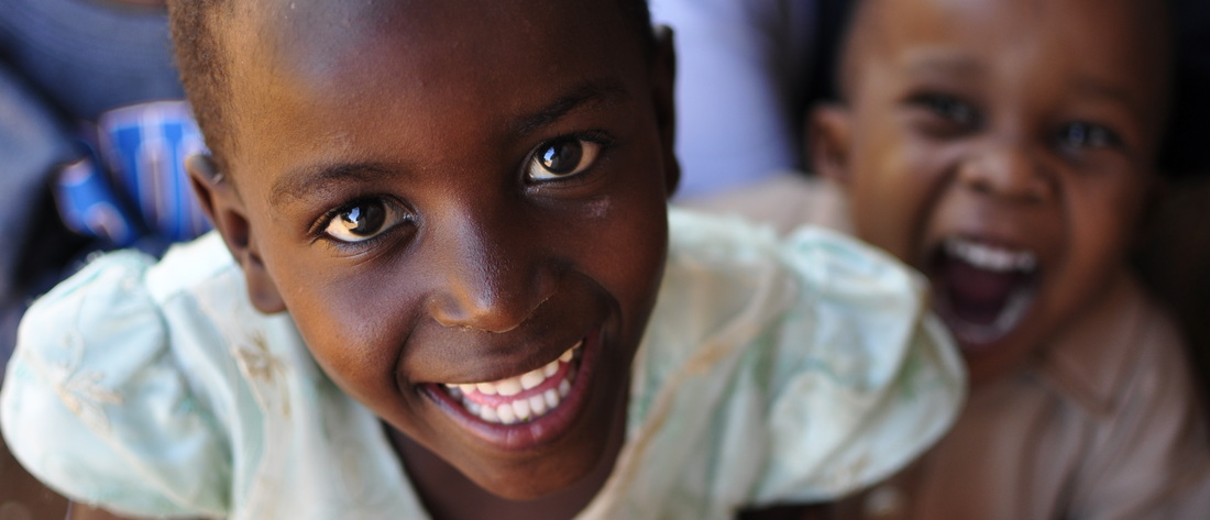 Photograph of a smiling girl in Kenya
