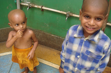 Photograph of two children in a washroom